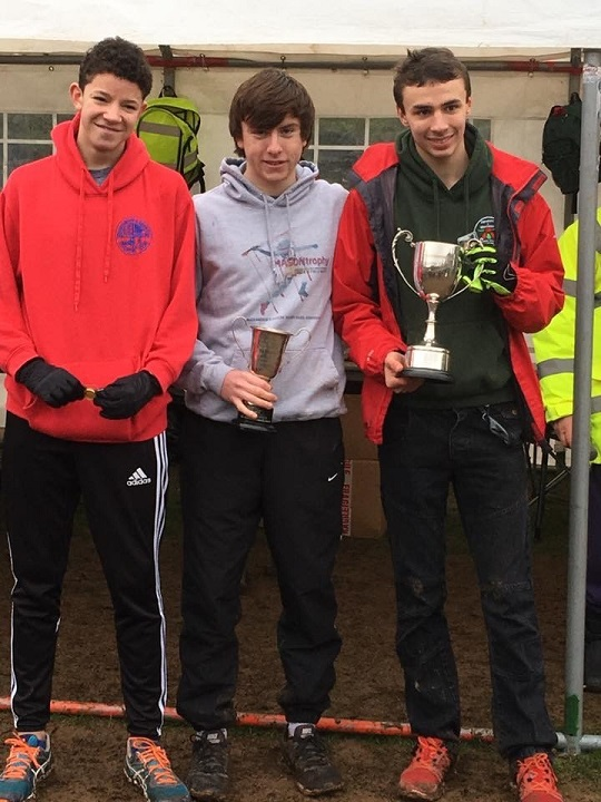 The Bromsgrove and Redditch AC Worcestershire County under 17 men's winning team : from left to right Alex Johnson 8th, Conor Smith (also individual champion with trophy) and Gareth Richardson 3rd (holding the team trophy)